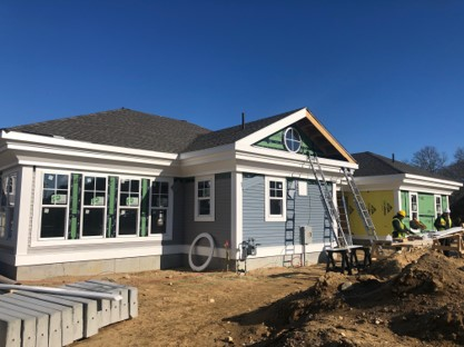 A before image of window + siding work in Yarmouth Massachusetts