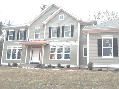 An image of a completed siding job in Milton Massachusetts