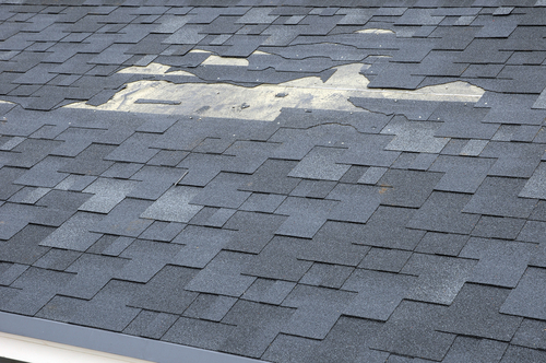 An image of missing shingles that need to be replaced