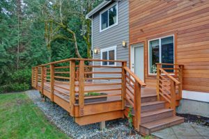 An image of wood and vinyl siding