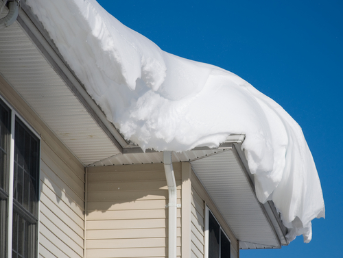 snow on roof that can cause a cave in