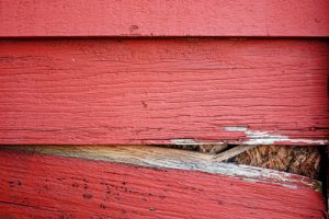 An example of damaged siding