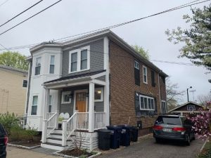 A before image of a siding project Novus Exteriors did in Cambridge