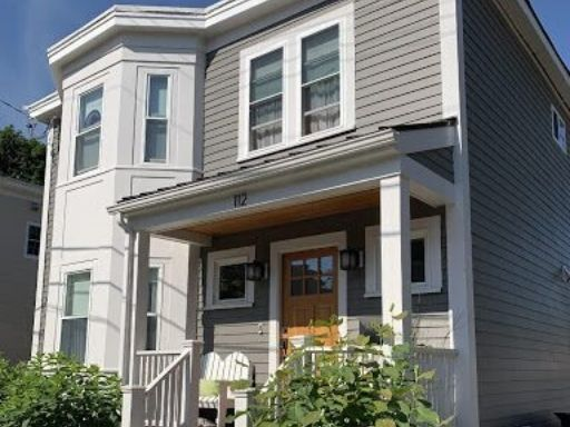 A completed siding installation job done in Cambridge Massachusetts