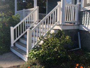 Completed work on a porch staircase