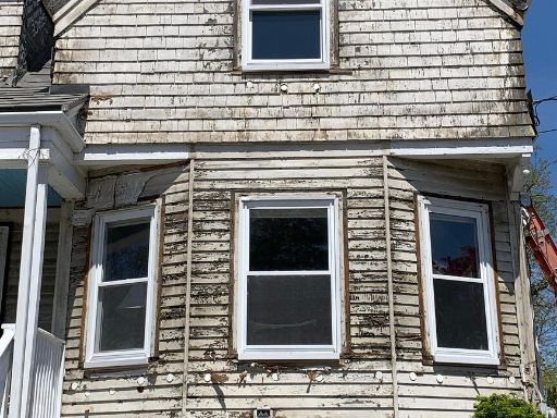 a before picture of destroyed siding