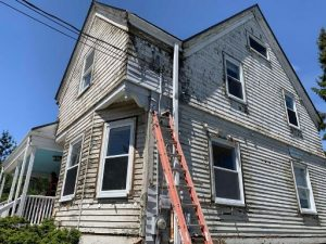 a before image of siding work being completed