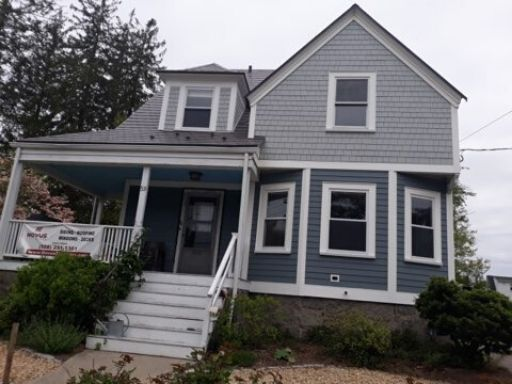 A completed siding and porch renovation job in Braintree